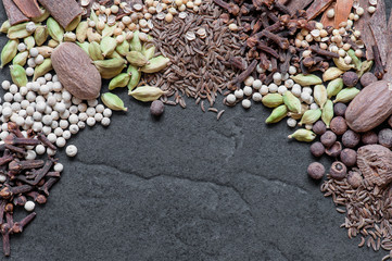 Various spices on the textured background