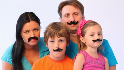 portrait of father, mother, daughter and son with false moustaches at all close up