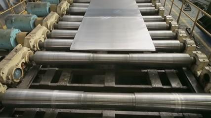Aluminum sheet moves on transporter of rolling mill in workshop