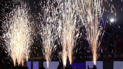 Fireworks near stage during concert show in dark hall