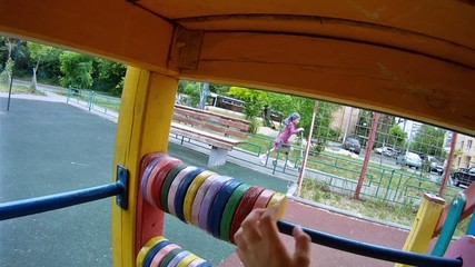 Boy accounts on toy abacus on playground