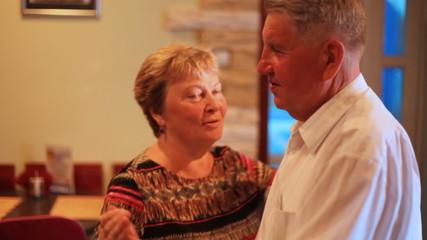 elderly pair dances together at restaurant close up