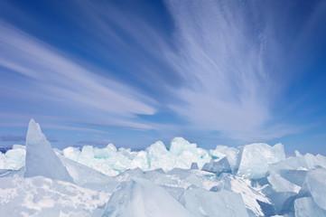 Lake Baikal. Stratus clouds over the ice hummocks