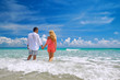 Happy young romantic couple standing on the beach