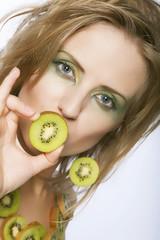 woman with kiwi on white