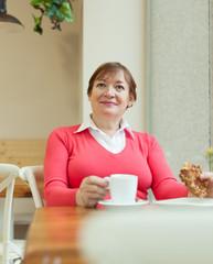 Elderly woman sitting in   cafe