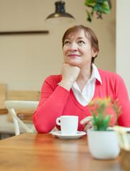 senior lady in   cafe.