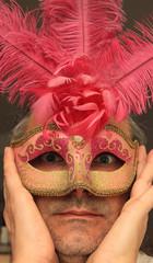 man wearing a Pink Mask
