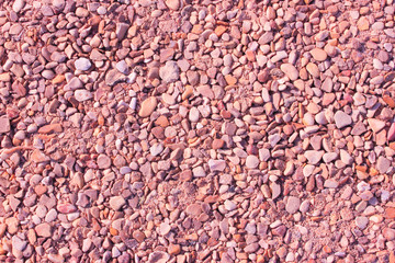 Pebble background at sun light.