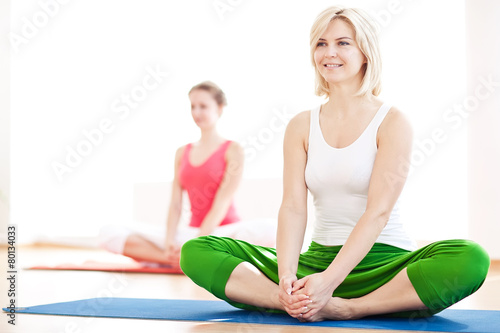 Two yogas woman indoors - 80134033