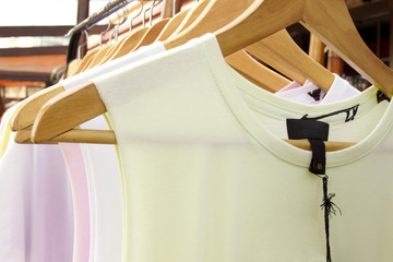 T-Shirts on hangers close up