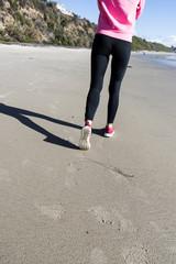 Athlete runner feet on the beach