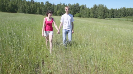 man and woman to hold hands and go forward across field