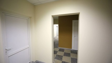 Entrance to new residential house, empty corridors, mailboxes.