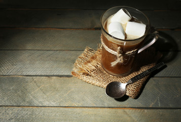 Glass cup of cocoa with marshmallows