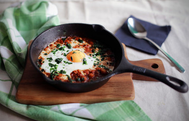 Poached egg in tomato sauce, traditional arabic shakshouka