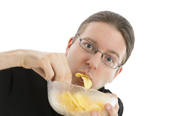 Man eating potato chips hurriedly