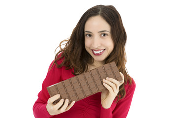 Attractive woman with a big chocolate bar
