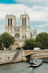 Notre Dame  with boat on Seine, France