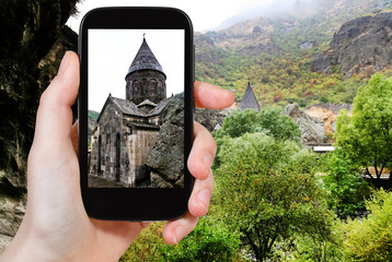 tourist photographs geghard monastery in Armenia