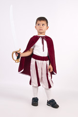 The Little Prince in costume with sword