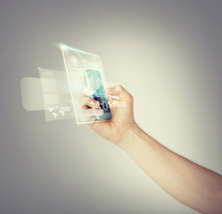 man hand with smartphone and virtual screen