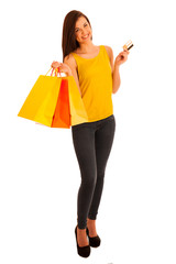 Portrait of young happy smiling woman with shopping bags, isolat