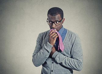 Portrait geeky nervous anxious man bitting chewing his tie