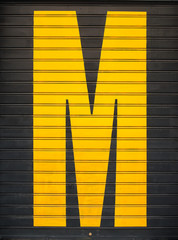 Yellow M on black shutter