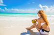 Young woman enjoying sunny day on tropical beach - 80139891
