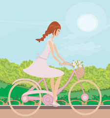 Girl is riding bike on spring field