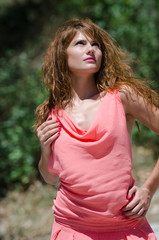 Greek fashion red hair woman wearing pink piece garment