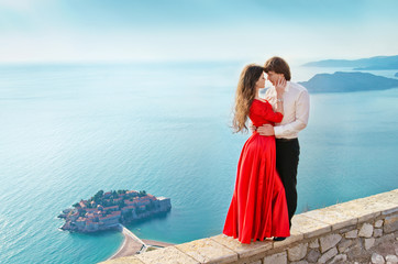 Young couple in love on romantic travel honeymoon vacation summe