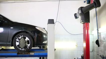Wheel balancing of downing car at modern Service station