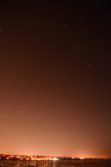 Light pollution over Small City With Constellation Orion