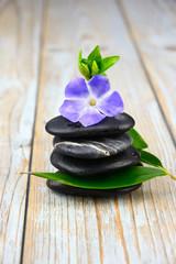 Black warmth zen stones decoration on old wooden background