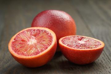 red sicilian oranges sliced on wooden table