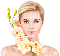 woman with healthy skin and flowers close to face