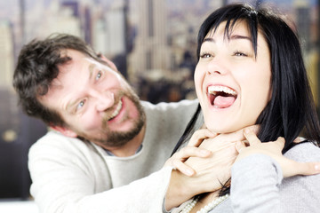 Couple fighting funny smiling