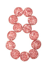 Number 8 arranged from salami sausage slices isolated