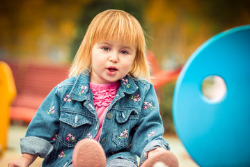 little  girl playing at the playground