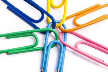 Team. Joined mult-colored paperclips on white background