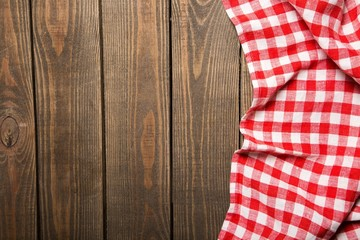Top. old wooden table with red picnic tablecloth and copyspace