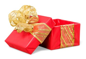 Gift. Red Christmas gift box with its lid propped at an angle in