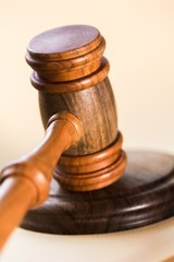 Court. Close up of a wooden judge or auctioneers gavel with a