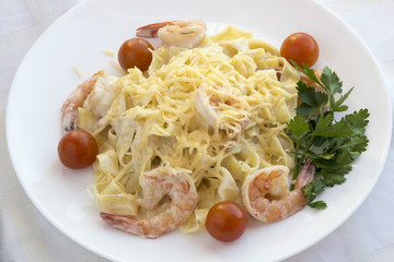 Pasta with prawns and cherry tomatoes.