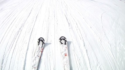 Man goes slowly on skis on pure snow from mountain