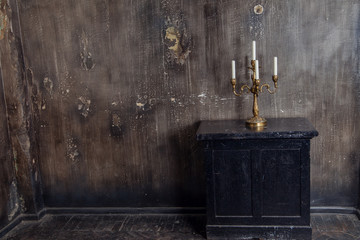 Old grunge interior with candles