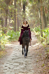 woman in medieval dress riding horseback