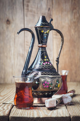 Turkish tea with oriental sweets on a wooden table